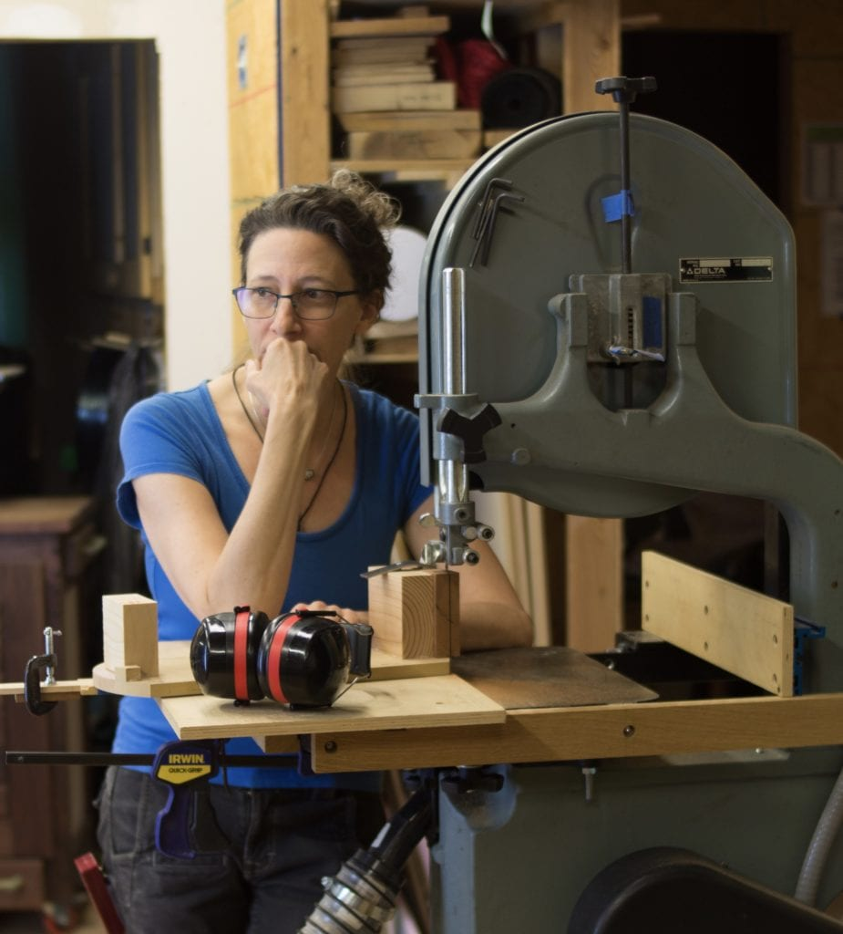 Female woodworker and instructor, Kelly Parker with her bandsaw